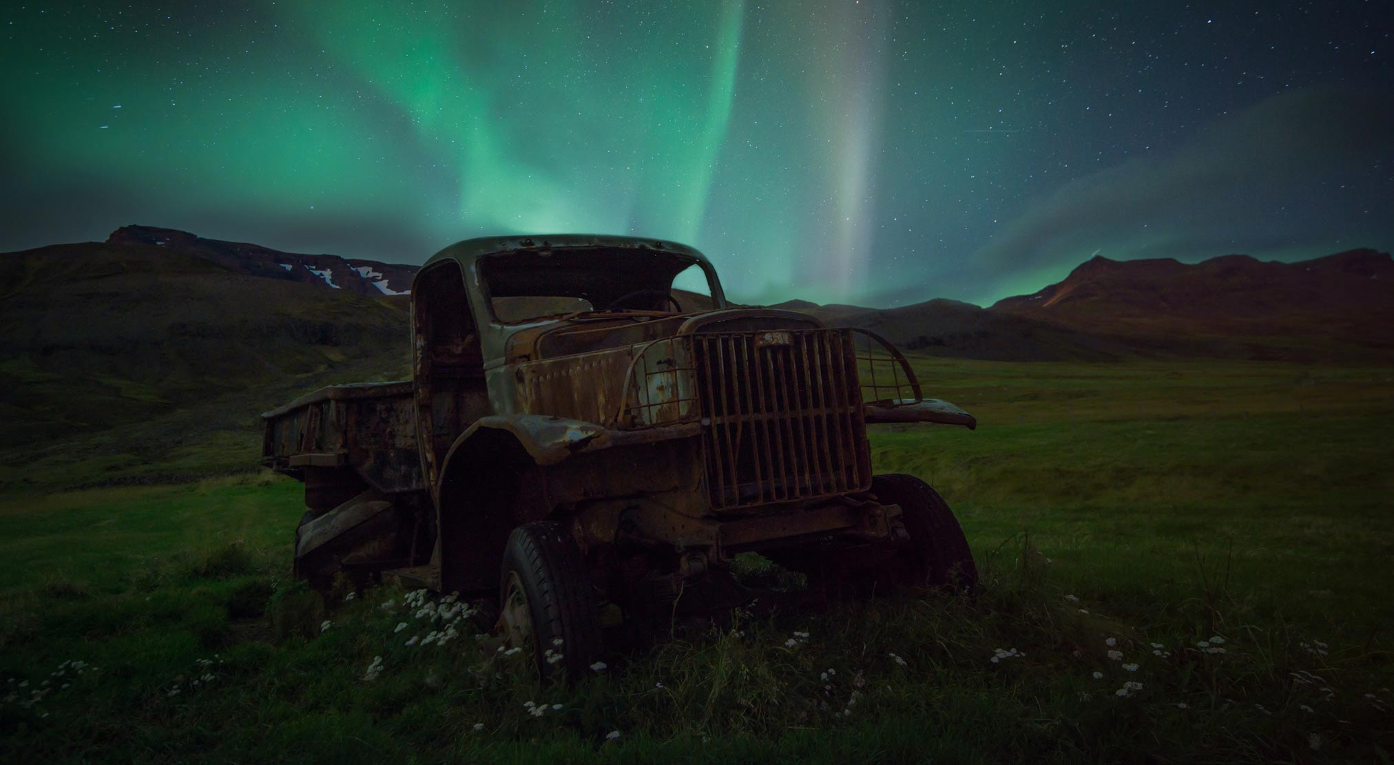 Iceland old truck northern lights