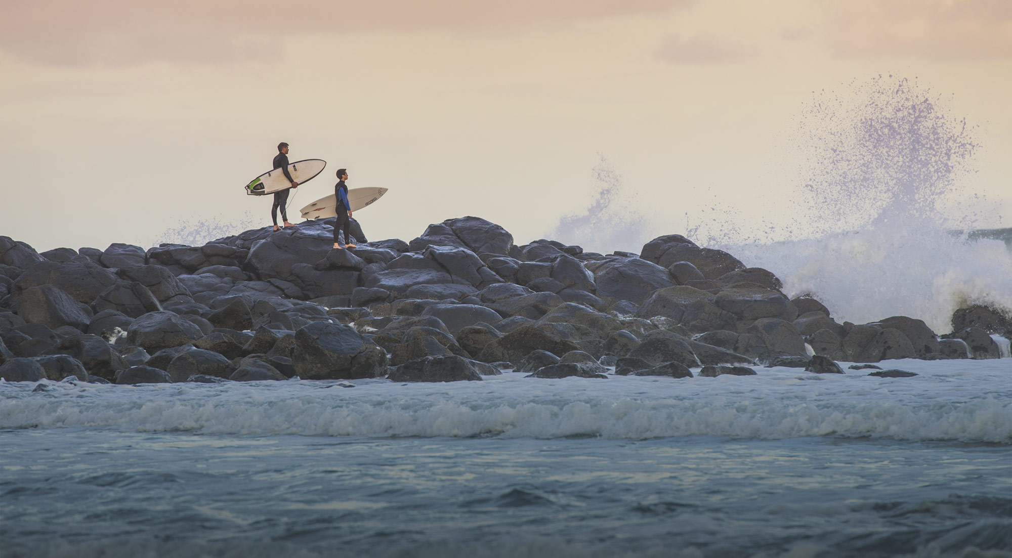new zealand surfers motivating themselves into the waves